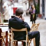 between jobs man suite outside phone
